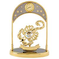 """Сувенир с часами """"Знак зодиака: Скорпион"""", золотого цвета, станет необычным аксессуаром для Вашего интерьера и создаст незабываемую атмосферу. Кристаллы, украшающие сувенир, носят громкое имя  Swarovski. Ограненные, как бриллианты, кристаллы блистают сотнями тысяч различных оттенков.   Эта очаровательная вещь послужит отличным подарком близкому человеку, родственнику или другу, а также подарит приятные мгновения и окунет Вас в лучшие воспоминания.   Характеристики: Материал: металл (углеродистая сталь, покрытие золотом 0,05 микрон), австрийские кристаллы. Размер: 13,5 см х 10 см х 4,5 см. Диаметр циферблата часов: 2 см. Цвет: золотой. Размер упаковки: 14 см х 7,5 см х 10,5 см. Изготовитель: Польша. Артикул: 67331.   Более чем 30 лет назад компания  """"Crystocraft""""  выросла из ведущего производителя в перспективную торговую марку, которая задает тенденцию благодаря безупречному чувству красоты и стиля.  Компания создает изящные, качественные, яркие сувениры, декорированные кристаллами  Swarovski  различных размеров и оттенков, сочетающие в себе превосходное мастерство обработки металлов и самое высокое качество кристаллов.  Каждое изделие оформлено в индивидуальной подарочной упаковке, что придает ему завершенный и презентабельный вид."""