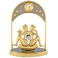 """Сувенир с часами """"Знак зодиака: Близнецы"""", золотого цвета, станет необычным аксессуаром для Вашего интерьера и создаст незабываемую атмосферу. Кристаллы, украшающие сувенир, носят громкое имя  Swarovski. Ограненные, как бриллианты, кристаллы блистают сотнями тысяч различных оттенков.   Эта очаровательная вещь послужит отличным подарком близкому человеку, родственнику или другу, а также подарит приятные мгновения и окунет Вас в лучшие воспоминания.   Характеристики: Материал: металл (углеродистая сталь, покрытие золотом 0,05 микрон), австрийские кристаллы. Размер: 13,5 см х 10 см х 4,5 см. Диаметр циферблата часов: 2 см. Цвет: золотой. Размер упаковки: 14 см х 7,5 см х 10,5 см. Изготовитель: Польша. Артикул: 67326.   Более чем 30 лет назад компания  """"Crystocraft""""  выросла из ведущего производителя в перспективную торговую марку, которая задает тенденцию благодаря безупречному чувству красоты и стиля.  Компания создает изящные, качественные, яркие сувениры, декорированные кристаллами  Swarovski  различных размеров и оттенков, сочетающие в себе превосходное мастерство обработки металлов и самое высокое качество кристаллов.  Каждое изделие оформлено в индивидуальной подарочной упаковке, что придает ему завершенный и презентабельный вид."""