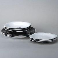 Столовый набор Carine White & Black, 18 предметовD2380Столовый набор Carine White & Black сочетает в себе изысканный дизайн с максимальной функциональностью. Благодаря квадратным тарелкам черного и белого цветов набор выглядит необычно, но в то же время элегантно и торжественно. Набор состоит из 6 больших тарелок, 6 средних тарелок, 6 малых тарелок. Все предметы набора изготовлены из упрочненного декорированного стекла, благодаря чему посуда будет использоваться очень долго, при этом сохраняя свой внешний вид. Практичный и современный дизайн делает набор довольно простым и удобным в эксплуатации. Характеристики: Материал: стекло. Размер обеденной тарелки: 26 см х 26 см. Размер суповой тарелки: 21 см х 21 см. Глубина суповой тарелки:5 см. Размер десертной тарелки: 19 см х 19 см. Размер упаковки: 27 см х 26,5 см х 16 см. Артикул: D2380. Производитель: Франция.На сегодняшний день наборы посуды с фирменным знаком Luminarc являются самыми востребованными везде, даже в самых удаленных уголках нашей планеты. Кухонную посуду Luminarcможно встретить в барах и ресторанах, в гостиницах и офисах, в кафе и домашней кухне. Одно слово Luminarcуже говорит о том, что здесь знают толк в посуде. Французская пословица гласит: Хорошая кастрюля - хороший обед!Эта фраза очень точно передает смысл работы изготовителей посуды Luminarc. Ведь в понятие хороший обед входит не только удобство приготовления пищи, но и эстетическое удовольствие, получаемое от изумительного вида подаваемых блюд. Поэтому все без исключения наборы посуды, создаваемые этой великолепной фирмой, безусловно, удовлетворяют запросам самого взыскательного покупателя.