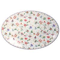 Блюдо Букингем, овальноеIMC1185-A218ALОвальное блюдо Букингем, выполненное из керамики и декорированное цветочным рисунком, сочетает в себе изысканный дизайн с максимальной функциональностью. Красочность оформления придется по вкусу и ценителям классики, и тем, кто предпочитает утонченность и изящность.Блюдо Букингем украсит сервировку вашего стола и подчеркнет прекрасный вкус хозяина, а также станет отличным подарком. Характеристики: Материал: керамика. Размер: 38 см х 26 см. Размер упаковки: 38,5 см х 27,5 см х 3,5 см. Производитель: Китай. Артикул:IMC1185-A218AL.Изделия торговой марки Imari произведены из высококачественной керамики, основным ингредиентом которой является твердый доломит, поэтому все керамические изделия Imari - легкие, белоснежные, прочные и устойчивы к высоким температурам. Высокое качество изделий достигается не только благодаря использованию особого сырья и новейших технологий и оборудования при изготовлении посуды, но также благодаря строгому контролю на всех этапах производственного процесса. Нанесение сверкающей глазури, не содержащей свинца, придает изделиям Imari превосходный блеск и особую прочность.Красочные и нежные современные декоры Imari - это результат профессиональной работы дизайнеров, которые ежегодно обновляют ассортимент и предлагают покупателям десятки новый декоров. Свою популярность торговая марка Imari завоевала благодаря высокому качеству изделий, стильным современным дизайнам, широчайшему ассортименту продукции, прекрасным подарочным упаковкам и низким ценам. Все эти качества изделий сделали их безусловным лидером на рынке керамической посуды.