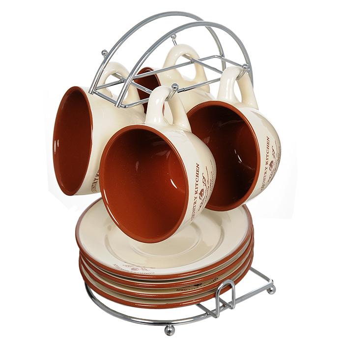 Набор чайный Terracotta Кухня в стиле Кантри 9 предметов TLY314-CK-ALTLY314-CK-ALЧайный набор Кухня в стиле Кантри состоит из металлической подставки, 4 блюдец и 4 чашек. Предметы набора изготовлены из жаропрочной керамики и покрыты высококачественной глазурью. Такой чайный набор не оставит равнодушной не одну хозяйку или станет прекрасным подарком. Характеристики: Материал: металл, керамика. Диаметр блюдца: 15,7 см. Диаметр кружки по верхнему краю: 9 см. Диаметр основания кружки: 5 см. Высота кружки: 7 см. Объем кружки: 200 мл. Размер подставки (Д х Ш х В): 17 см х 16,5 см х 24,5 см. Размер упаковки: 17,5 см х 17 см х 25 см. Производитель: Италия. Изготовитель: Китай. Артикул: TLY314-CK-AL. Торговая марка Terracotta - это коллекции разнообразной посуды для сервировки стола, хранения продуктов и приготовления пищи из жаропрочной керамики, покрытой высококачественной глазурью. Изделия Terracotta идеально подходят для выпечки, приготовления различных блюд и разогревания пищи в духовом шкафу или микроволновой печи. Может использоваться для хранения продуктов, в том числе в холодильнике. При приготовлении или охлаждении пищи рекомендуется использовать постепенный нагрев или охлаждение. Посуда торговой марки Terracotta совмещает в себе современные технологии и новые идеи, благодаря чему достигаются высокое качество, разнообразие форм и дизайнов.