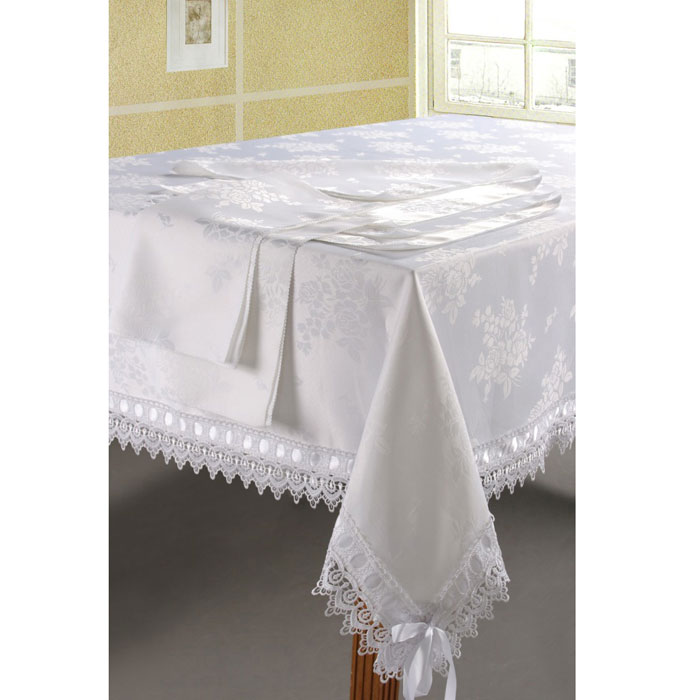 Комплект столового белья SL, цвет: белый, 7 предметов. 0845508455Роскошный комплект столового белья SL состоит из скатерти прямоугольной формы и шести квадратных салфеток. Комплект выполнен из ацетатного шелка с жаккардовым рисунком. Края скатерти декорированы изысканным кружевом и лентой. Комплект, несомненно, придаст интерьеру уют и внесет что-то новое. Использование такого комплекта сделает застолье более торжественным, поднимет настроение гостей и приятно удивит их вашим изысканным вкусом. Вы можете использовать этот комплект для повседневной трапезы, превратив каждый прием пищи в волшебный праздник и веселье.Жаккард - одна из дорогих тканей. Жаккардовые ткани очень прочны и долговечны, очень удобны в эксплуатации. Изготавливается жаккард благодаря особой технике плетения в основном из хлопчатобумажной, синтетической или смесовой пряжи. Своеобразный рельефный рисунок, который получается в результате сложного плетения на плотной ткани, напоминает своего рода гобелен. Комплект упакован в красивую подарочную коробку.Soft Line - мягкая эстетика для вас и вашего дома!Основанная в 1997 году, компания Soft Line является путеводителем по мягкому миру текстиля, полному удивительных достопримечательностей!Высочайшее качество тканей в сочетании с эксклюзивным дизайном и изысканными отделками неизменно привлекают как требовательного покупателя, так и взыскательного профессионала!Материал: жаккард (100% полиэстер).В комплект входит: Скатерть - 1 шт. Размер: 180 см х 210 см. Салфетки - 6 шт. Размер: 40 см х 40 см.