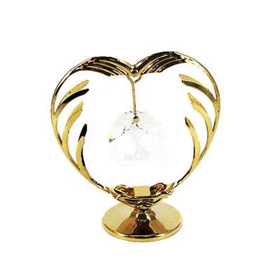 Миниатюра Сердце, цвет: золотистый, 7 см67114Миниатюра Сердце, золотистого цвета, станет необычным аксессуаром для вашего интерьера и создаст незабываемую атмосферу. Кристаллы, украшающие сувенир, носят громкое имяSwarovski - ограненные, как бриллианты, кристаллы блистают сотнями тысяч различных оттенков. Эта очаровательная вещь послужит отличным подарком близкому человеку, родственнику или другу, а также подарит приятные мгновения и окунет вас в лучшие воспоминания. Характеристики: Материал: металл (углеродистая сталь, покрытие золотом 0,05 микрон), австрийские кристаллы. Размер: 7 см х 6 см х 3 см. Цвет: золотистый. Размер упаковки: 9 см х 7 см х 4,5 см. Изготовитель: Китай. Артикул: 67114. Более чем 30 лет назад компанияCrystocraftвыросла из ведущего производителя в перспективную торговую марку, которая задает тенденцию благодаря безупречному чувству красоты и стиля.Компания создает изящные, качественные, яркие сувениры, декорированные кристалламиSwarovskiразличных размеров и оттенков, сочетающие в себе превосходное мастерство обработки металлов и самое высокое качество кристаллов.Каждое изделие оформлено в индивидуальной подарочной упаковке, что придает ему завершенный и презентабельный вид.