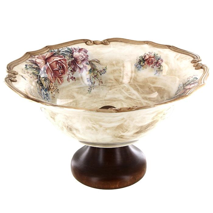 Ваза для фруктов ЭлиантоLCS038AL-EL-ALВаза Элианто прекрасно подойдет для красивой сервировки фруктов. Чаша вазы выполнена из высококачественной керамики, а ножка из дерева. Ваза оформлена красочным цветочным рисунком. Изящный дизайн и красочность оформления придутся по вкусу и ценителям классики, и тем, кто предпочитает утонченность и изысканность. Ваза для фруктов Элианто украсит сервировку вашего стола и подчеркнет прекрасный вкус хозяина, а также станет отличным подарком. Характеристики: Материал:керамика, дерево. Диаметр чаши по верхнему краю:30,5 см. Высота стенки чаши:9,5 см. Высота ножки:10 см. Диаметр основания ножки:12,5 см. Размер упаковки:36,5 см х 12 см х 37 см. Производитель:Италия. Артикул:LCS038AL-EL-AL. LCS - молодая, динамично развивающаяся итальянская компания из Флоренции, производящая разнообразную керамическую посуду и изделия для украшения интерьера. В своих дизайнах LCS использует как классические, так и современные тенденции. Высокий стандарт изделий обеспечивается за счет соединения высоко технологичного производства и использования ручной работы профессиональных дизайнеров и художников, работающих на фабрике.