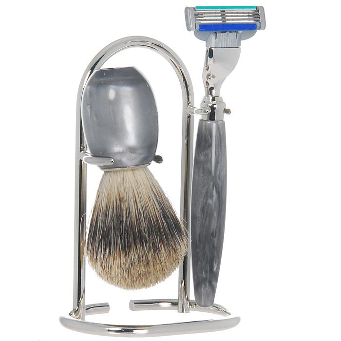 Подарочный набор для бритья S.Quire. 62166216Подарочный набор для бритья состоит из оригинальной подставки, бритвенного станка с лезвием Gillette Mach 3 и кисточки-помазка из натурального ворса. Бритвенный станок с лезвием Gillette Mach 3 обеспечивает чистое бритье. Система с тройным лезвием нового поколения позволяет Gillette Mach3  удалять каждый волос еще чище с меньшим раздражением кожи. Такой набор украсит интерьер вашей ванной комнаты и станет отличным подарком для мужчин, ценящих практичные подарки. Характеристики: Материал: металл, акрил, ПМ, натуральный ворс. Высота подставки: 13 см. Длина станка: 14,5 см. Длина лезвия: 4 см. Длина кисточки-помазка: 9,5 см. Размер упаковки: 16,5 см х 8 см х 10 см. Артикул: 6216. Изготовитель: Италия.