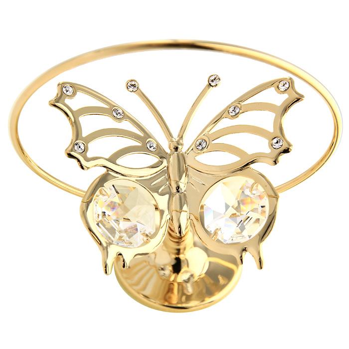 """Настольный вращающийся сувенир """"Летящая бабочка"""", украшен прозрачными кристаллами Swarovski. Сувенир изготовлен из высококачественной стали. Оригинальный сувенир будет отличным подарком для ваших друзей и коллег.Более 30 лет компания """"Crystocraft"""" создает качественные, красивые и изящные сувениры, декорированные различными кристаллами Swarovski.    Характеристики: Материал:  сталь, кристаллы Swarovski. Высота:  7 см. Размер коробки:  7,5 см х 10 см х 5 см. Артикул:  U0003-101-GC1. Производитель: Китай."""