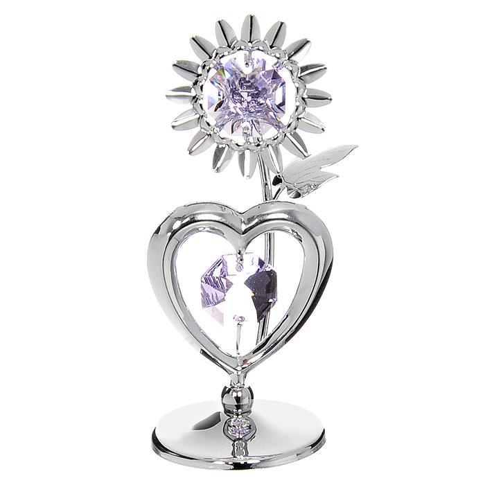 Миниатюра Подсолнух с сердцем, цвет: серебристый, 7,5 смU0174-001-CVLМиниатюра Подсолнух с сердцем серебристого цвета, станет необычным аксессуаром для вашего интерьера и создаст незабываемую атмосферу. Кристаллы, украшающие сувенир, носят громкое имя Swarovski. Ограненные, как бриллианты, кристаллы блистают сотнями тысяч различных оттенков.Эта очаровательная вещь послужит отличным подарком близкому человеку, родственнику или другу, а также подарит приятные мгновения и окунет Вас в лучшие воспоминания. Характеристики: Материал: металл, австрийские кристаллы. Высота миниатюры: 7,5 см. Цвет: серебристый. Размер упаковки: 6,5 см х 9 см х 4,5 см. Изготовитель: Китай. Артикул: U0174-001-CVL. Более чем 30 лет назад компанияCrystocraftвыросла из ведущего производителя в перспективную торговую марку, которая задает тенденцию благодаря безупречному чувству красоты и стиля. Компания создает изящные, качественные, яркие сувениры, декорированные кристалламиSwarovskiразличных размеров и оттенков, сочетающие в себе превосходное мастерство обработки металлов и самое высокое качество кристаллов. Каждое изделие оформлено в индивидуальной подарочной упаковке, что придает ему завершенный и презентабельный вид.