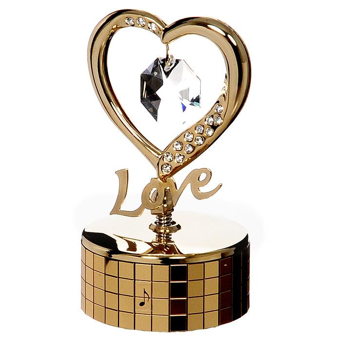 Миниатюра Сердце, цвет: золотистый, музыкальнаяU0252-081-GC1Миниатюра Сердце на музыкальной подставке, золотистого цвета, станет необычным аксессуаром для вашего интерьера и создаст незабываемую атмосферу. Кристаллы, украшающие сувенир, носят громкое имя Swarovski. Ограненные, как бриллианты, кристаллы блистают сотнями тысяч различных оттенков.Эта очаровательная вещь послужит отличным подарком близкому человеку, родственнику или другу, а также подарит приятные мгновения и окунет Вас в лучшие воспоминания. Характеристики: Материал: металл, австрийские кристаллы. Размер миниатюры: 5 см х 9 см х 5 см. Цвет: золотистый. Размер упаковки: 7 см х 9 см х 4,5 см. Изготовитель: Китай. Артикул: U0252-081-GC1. Более чем 30 лет назад компанияCrystocraftвыросла из ведущего производителя в перспективную торговую марку, которая задает тенденцию благодаря безупречному чувству красоты и стиля. Компания создает изящные, качественные, яркие сувениры, декорированные кристалламиSwarovskiразличных размеров и оттенков, сочетающие в себе превосходное мастерство обработки металлов и самое высокое качество кристаллов. Каждое изделие оформлено в индивидуальной подарочной упаковке, что придает ему завершенный и презентабельный вид.