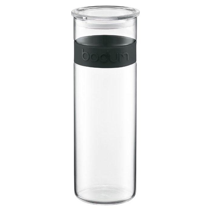 Банка для хранения Presso, цвет: черный, 1,9 л11132-01Банка для хранения Bodum Presso, выполненная из прозрачного боросиликатного стекла, станет незаменимым помощником на кухне. В такой банке будет удобно хранить разнообразные сыпучие продукты, такие как кофе, крупы, макароны или специи. Она не впитывает запахов продуктов и очень удобна в использовании. В верхней части банки имеется вставка из приятного на ощупь силикона. Емкость легко и герметично закрывается пластиковой крышкой с уплотнителем. Боросиликатное стекло и силикон выдерживают нагрев до очень высоких температур и приспособлены для мытья в посудомоечной машине. Банка для хранения Bodum Presso не только сэкономит место на вашей кухне, но и украсит интерьер. Оригинальный дизайн позволит сделать такую банку отличным подарком на любой праздник. Характеристики:Материал: стекло, пластик. Объем банки:1,9 л. Диаметр банки:9,5 см. Высота банки (без учета крышки):28 см. Цвет вставки:черный. Размер упаковки:11 см х 29,5 см х 10,5 см. Производитель:Швейцария. Артикул:11132-01.