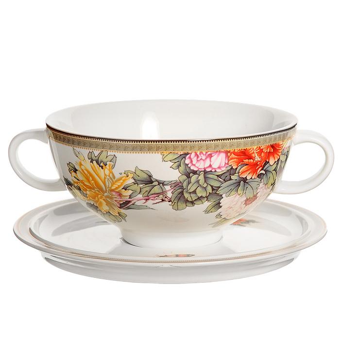 Суповая чашка Японский сад на блюдцеIMB0304-1730ALСуповая чашка Японский сад, изготовленная из керамики, предназначена для порционной подачи супов, бульонов, гуляшей и прочих первых блюд. В комплект с чашкой входит блюдце-подставка. Чашка и блюдце оформлены красочным рисунком с изображением цветов. Суповая чашка Японский сад украсит ваш обеденный стол и привнесет в интерьер уют. Чашка для супа также может стать великолепным подарком для родственников или друзей.Керамическая чашка идеально подходит для приготовления различных блюд и разогревания пищи в духовом шкафу или микроволновой печи. Характеристики: Материал: керамика. Диаметр чашки по верхнему краю: 14 см. Высота чашки:6,5 см. Объем чашки:0,5 л. Диаметр блюдца:18 см. Размер упаковки: 18,5 см х 9 см х 18,5 см. Производитель: Китай. Артикул: IMB0304-1730AL.Изделия торговой марки Imari произведены из высококачественной керамики, основным ингредиентом которой является твердый доломит, поэтому все керамические изделия Imari - легкие, белоснежные, прочные и устойчивы к высоким температурам. Высокое качество изделий достигается не только благодаря использованию особого сырья и новейших технологий и оборудования при изготовлении посуды, но также благодаря строгому контролю на всех этапах производственного процесса. Нанесение сверкающей глазури, не содержащей свинца, придает изделиям Imari превосходный блеск и особую прочность.Красочные и нежные современные декоры Imari - это результат профессиональной работы дизайнеров, которые ежегодно обновляют ассортимент и предлагают покупателям десятки новый декоров. Свою популярность торговая марка Imari завоевала благодаря высокому качеству изделий, стильным современным дизайнам, широчайшему ассортименту продукции, прекрасным подарочным упаковкам и низким ценам. Все эти качества изделий сделали их безусловным лидером на рынке керамической посуды.