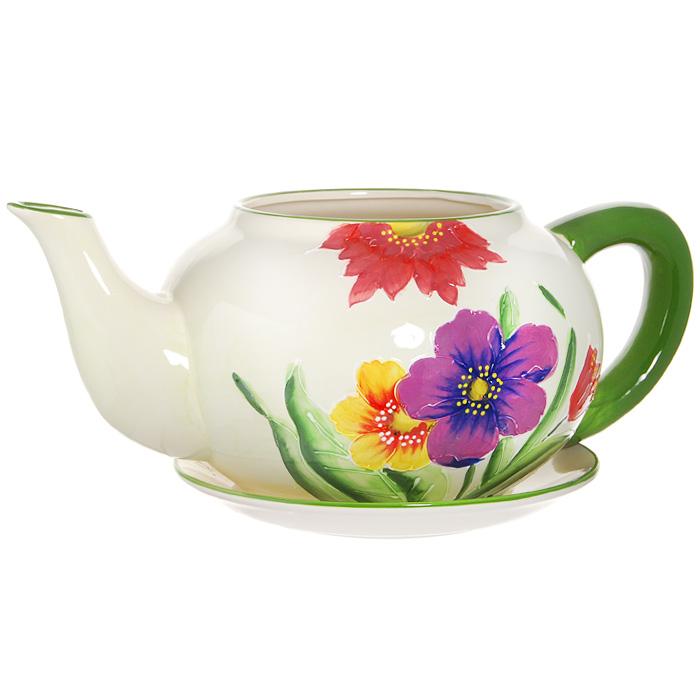 Горшок для цветов, с поддоном. XY10S012A77489Горшок для цветов, изготовленный из керамики, выполнен в виде заварочного чайника, который предназначен для установки внутрь растения.Горшок, оформленный яркими красками, обладает долговечностью и износостойкостью. Это изделие не потеряет яркости красок и четкости форм даже после длительной эксплуатации. Горшок для цветов часто становится последним штрихом, который совершенно изменяет интерьер помещения или ландшафтный дизайн сада. Благодаря такому горшку вы сможете украсить вашу комнату, офис, сад и другие места. Характеристики:Материал: керамика. Диаметр отверстия для цветов:15 см. Максимальный диаметр горшка (без учета ручки и носика):23 см. Высота горшка:17 см. Диаметр поддона:23 см. Размер упаковки:32 см х 19 см х 26 см. Изготовитель:Китай. Артикул:XY10S012A.