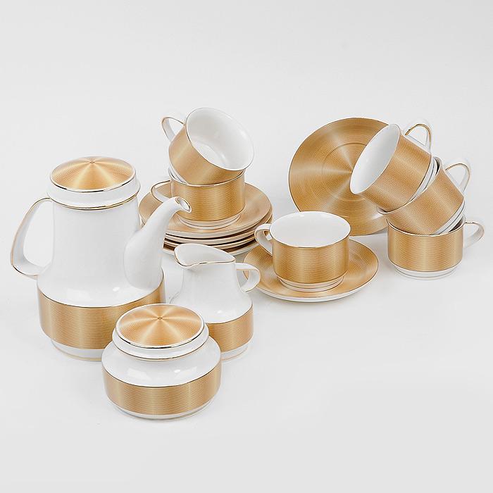 Чайный сервиз Сахара Голд, 15 предметов4601137092829Чайный сервиз Сахара Голд станет украшением сервировки вашего стола, а также послужит замечательным подарком к любому празднику. Он состоит из шести чашек, шести блюдец, заварочного чайника, сахарницы и молочника. Предметы набора изготовлены из высококачественного фарфора и имеют оригинальное оформление. Такой чайный сервиз настроит на позитивный лад и подарит хорошее настроение. Красочный дизайн придется по вкусу и ценителям классики, и тем, кто предпочитает утонченность и изысканность. Чайный сервиз упакован в стильную подарочную коробку из плотного картона. Внутренняя часть коробки задрапирована белым атласом, и каждый предмет надежно крепится в определенном положении благодаря особым выемкам. Характеристики: Материал:фарфор. Диаметр чашки по верхнему краю:8,5 см. Высота чашки:5,7 см. Диаметр блюдца:14,5 см. Диаметр чайника по верхнему краю (без учета носика и ручки):8,5 см. Максимальный диаметр чайника:13 см. Высота чайника (без учета крышки):16,5 см. Диаметр сахарницы по верхнему краю:8,5 см. Максимальный диаметр сахарницы:11,5 см. Высота сахарницы (без учета крышки):6 см. Максимальный диаметр молочника:8,5 см. Высота молочника:11 см. Размер упаковки:42,5 см х 14 см х 41 см. Производитель:Китай. Артикул:SCB 02Y1.