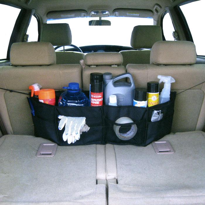 Органайзер автомобильный Comfort Adress, цвет: черныйbag 025Классический автомобильный органайзер Comfort Adress устанавливается в самый дальний нижний угол багажника. Органайзер выполнен из непромокаемой ткани, которая защитит вещи от влаги и грязи. При небольших размерах, он вмещает в себя все, что необходимо в дороге. К низу пришиты липучки, которые держат его на месте. Характеристики: Материал: непромокаемая ткань ПВХ 600D. Размер (Д х Ш х В): 76 см х 15 см х 25 см. Цвет: черный. Производитель: Россия. Артикул: bag 025.