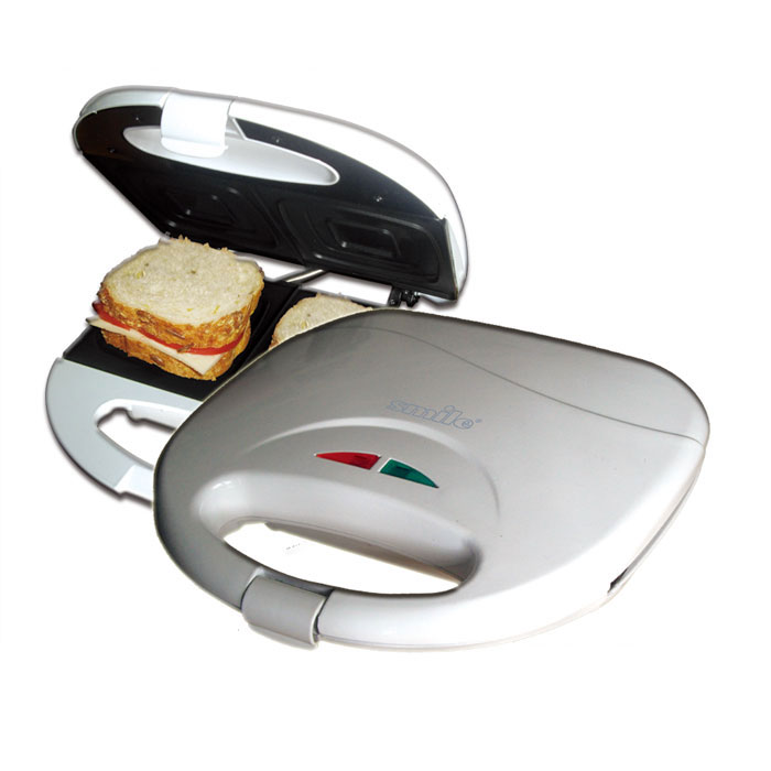 Smile ST 936 сэндвич-тостерST 936Бутербродница Smile ST 936 отлично подойдет для приготовления сэндвичей и быстрого поджаривания плоскихкусков хлеба. Данная модель имеет противоскользящие ножки, термоизолированный корпус и ручку длямаксимальной безопасности при эксплуатации. Рабочая поверхность обладает антипригарным покрытием, чтоделает процесс приготовления простым и удобным. Следить за состоянием прибора помогут 2 контрольныелампочки для сети и нагревательного элемента.