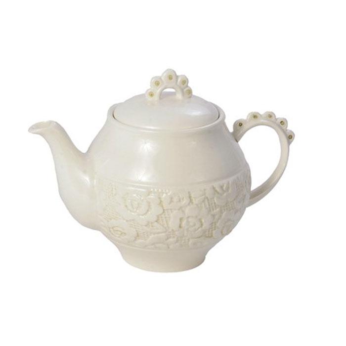 Чайник заварочный Georgia0721864Заварочный чайник Georgia, выполненный из керамики, сочетает в себе изысканный дизайн с максимальной функциональностью. Красочность оформления придется по вкусу и ценителям классики, и тем, кто предпочитает утонченность и изысканность. Характеристики:Материал:керамика. Высота чайника (без крышки): 11 см. Диаметр чайника (без носика и ручки): 12 см. Размер упаковки: 16 см х 13 см х 12,5 см. Артикул:0721864.
