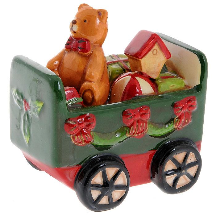 Декоративная фигурка Поезд. 2570225702Декоративная фигурка из керамики выполнена в виде вагончика, в котором сидит мишка с новогодними подарками. Фигурка станет отличным дополнением к праздничному интерьеру вашего дома.Порадуйте себя и своих близких этим чудесным сувениром! Характеристики:Материал:керамика. Размер фигурки:10 см х 5,5 см х 10,5 см. Размер упаковки: 12 см х 8 см х 12 см. Изготовитель:Китай. Артикул: 25702.