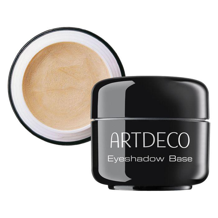 Artdeco База под тени для век Eyeshadow Base, 5 мл2910База для теней Artdeco Eyeshadow Base жемчужно-телесного цвета с кремовой текстурой и максимальным светоотражением помогает корректировать недостатки и цветовые несовершенства кожи, готовит веко для нанесения теней. Этот продукт специально создан, чтобы подчеркнуть красоту цвета и текстуры теней для век. Макияж глаз благодаря использованию Artdeco Eyeshadow Base становиться максимально стойким. Уникальный комплекс антисептиков, увлажнителей и витаминов успокаивают покраснения на веках. Применение:на чистое веко нанесите подушечками пальцев небольшое количество базы, распределив по верхнему веку. Дайте зафиксироваться текстуре в течение минуты и наносите тени или карандаш.Обязательно плотно закрывайте крышку после каждого использования. Характеристики:Объем: 5 мл. Производитель: Германия. Артикул: 2910. Товар сертифицирован.
