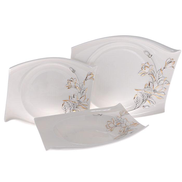 Набор тарелок Палаццо, 3 штGW 10005-22J35Набор Палаццо состоит из трех тарелок разного размера: большая мелкая тарелка, средняя глубокая тарелка и маленькая мелкая тарелка. Тарелки выполнены из высококачественного фарфора белого цвета и декорированы рельефным изображением лилий серебристо-золотистого цвета.Оригинальная форма и красочность оформления придется по вкусу и ценителям классики, и тем, кто предпочитает утонченность и изящность.Такой набор тарелок непременно украсит ваш праздничный стол.Набор тарелок упакован в стильную подарочную картонную коробку с логотипом компании. Характеристики:Материал: фарфор. Размер большой мелкой тарелки: 25 см х 19 см х 3 см. Размер средней глубокой тарелки: 22 см х 18 см х 3,5 см. Размер маленькой мелкой тарелки: 20 см х 16 см х 2 см. Размер упаковки: 29,5 см х 25 см х 8,5 см. Артикул: GW 10005-22J35.