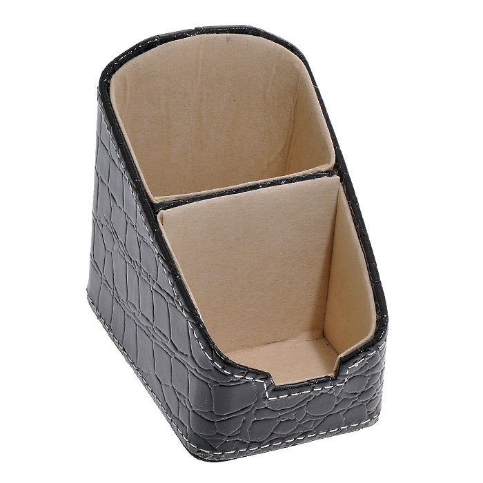 Подставка для канцелярских принадлежностей, цвет: черный. 2882328823Оригинальная подставка для канцелярских принадлежностей выполнена из пластика с отделкой из ПВХ, стилизованной под лаковую черную кожу с тиснением. Внутри отделана бархатистым материалом. Подставка состоит из двух отделений. Благодаря эксклюзивному дизайну, подставка оформит ваш рабочий стол, а также станет практичным сувениром для друзей и коллег. Характеристики: Материал: пластик, ПВХ, текстиль. Размер подставки: 10,5 см х 7 см х 10 см. Цвет: черный. Размер упаковки: 11,5 см х 8 см х 11 см. Артикул: 28823.