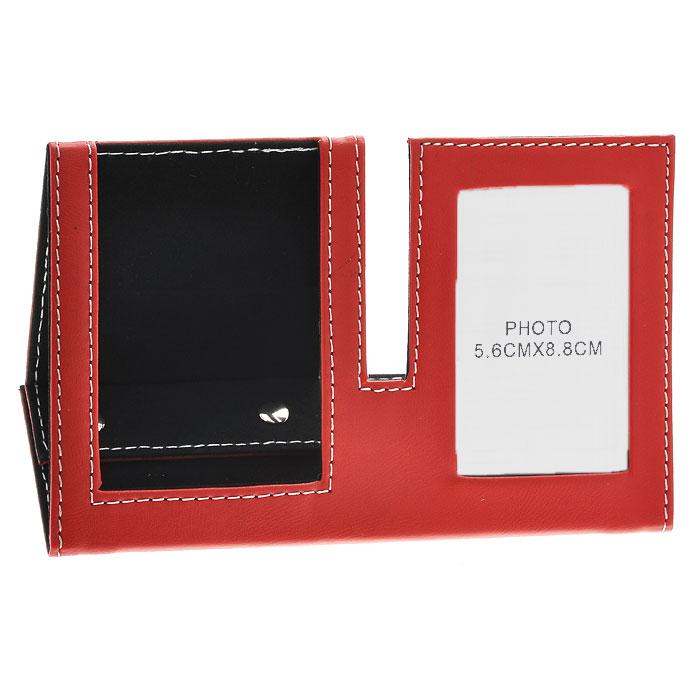 Подставка для мобильного телефона с рамкой для фото, цвет: красный, 5,5 см х 8,5 см. 2882928829Оригинальная подставка для мобильного телефона выполнена из картона с отделкой из ПВХ, стилизованной под кожу красного цвета. Внутренняя поверхность отделана бархатистым материалом. Подставка оформлена фоторамкой, в которую вы можете поместить фотографию любимого человека или счастливого события своей жизни. Благодаря эксклюзивному дизайну, подставка оформит ваш рабочий стол, а также станет практичным сувениром для друзей и коллег. Характеристики:Материал: картон, ПВХ, металл. Размер подставки: 19 см х 7 см х 8,5 см. Размер фоторамки: 8,3 см х 11,5 см. Размер фотографии: 5,5 см х 8,5 см. Размер упаковки: 19,5 см х 12,5 см х 1,5 см. Артикул:28829.