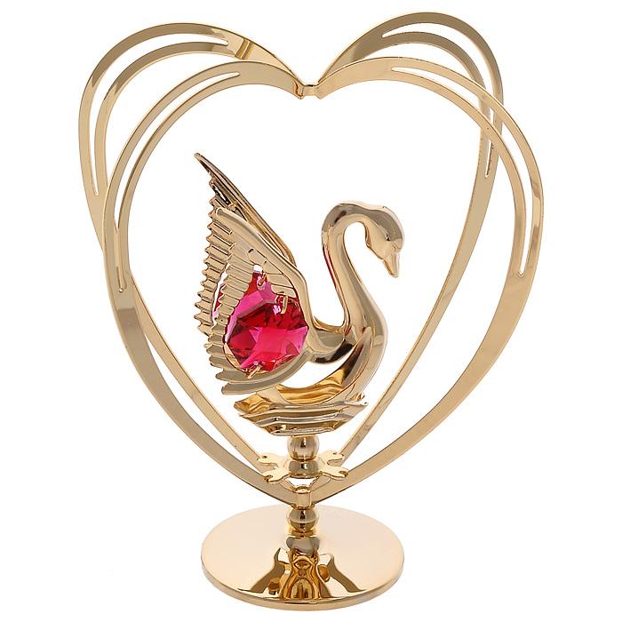 Фигурка декоративная Лебедь, цвет: золотистый67535Декоративная фигурка Лебедь, золотистого цвета, станет необычным аксессуаром для вашего интерьера и создаст незабываемую атмосферу. Фигурка выполнена в виде лебедя, размещенного в центре сердца, и декорирована красными кристаллами. Кристаллы, украшающие фигурку, носят громкое имяSwarovski. Ограненные, как бриллианты, кристаллы блистают сотнями тысяч различных оттенков.Эта очаровательная вещь послужит отличным подарком близкому человеку, родственнику или другу, а также подарит приятные мгновения и окунет вас в лучшие воспоминания.Фигурка упакована в подарочную коробку. Характеристики:Материал: металл (углеродистая сталь, покрытие золотом 0,05 микрон), австрийские кристаллы. Размер фигурки: 7,5 см х 9,5 см х 4,5 см. Цвет: золотистый. Размер упаковки: 9 см х 10 см х 6,5 см. Артикул: 67535. Более чем 30 лет назад компанияCrystocraftвыросла из ведущего производителя в перспективную торговую марку, которая задает тенденцию благодаря безупречному чувству красоты и стиля. Компания создает изящные, качественные, яркие сувениры, декорированные кристалламиSwarovskiразличных размеров и оттенков, сочетающие в себе превосходное мастерство обработки металлов и самое высокое качество кристаллов. Каждое изделие оформлено в индивидуальной подарочной упаковке, что придает ему завершенный и презентабельный вид.
