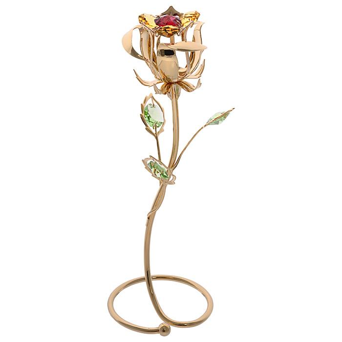 """Декоративная фигурка """"Роза"""", золотистого цвета, станет необычным аксессуаром для вашего интерьера и создаст незабываемую атмосферу. Фигурка выполнена в виде цветка розы на подставке и инкрустирована разноцветными кристаллами. Кристаллы, украшающие фигурку, носят громкое имя  Swarovski. Ограненные, как бриллианты, кристаллы блистают сотнями тысяч различных оттенков.  Эта очаровательная фигурка послужит отличным функциональным подарком, а также подарит приятные мгновения и окунет вас в лучшие воспоминания.Фигурка упакована в подарочную коробку.     Характеристики:Материал: металл (углеродистая сталь, покрытие золотом 0,05 микрон), австрийские кристаллы. Размер фигурки: 6,5 см х 18,5 см х 6,5 см.  Цвет: золотистый. Размер упаковки: 13,5 см х 23,5 см х 9,5 см. Артикул: 67575. Более чем 30 лет назад компания  """"Crystocraft""""  выросла из ведущего производителя в перспективную торговую марку, которая задает тенденцию благодаря безупречному чувству красоты и стиля. Компания создает изящные, качественные, яркие сувениры, декорированные кристаллами  Swarovski  различных размеров и оттенков, сочетающие в себе превосходное мастерство обработки металлов и самое высокое качество кристаллов. Каждое изделие оформлено в индивидуальной подарочной упаковке, что придает ему завершенный и презентабельный вид."""