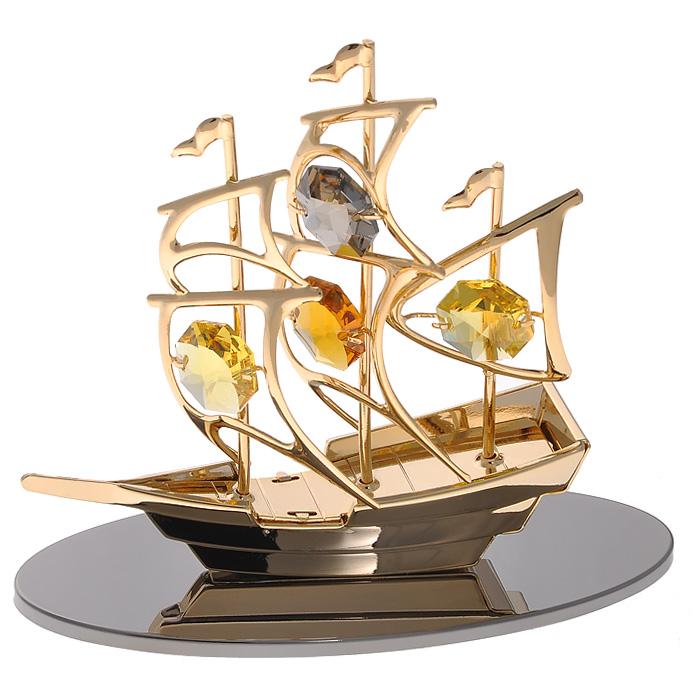 Фигурка декоративная Кораблик, цвет: золотистый67298Декоративная фигурка Кораблик, золотистого цвета, станет необычным аксессуаром для вашего интерьера и создаст незабываемую атмосферу. Фигурка выполнена в виде кораблика на зеркальной подставке и инкрустирована желтыми кристаллами. Кристаллы, украшающие фигурку, носят громкое имяSwarovski. Ограненные, как бриллианты, кристаллы блистают сотнями тысяч различных оттенков.Эта очаровательная вещь послужит отличным подарком близкому человеку, родственнику или другу, а также подарит приятные мгновения и окунет вас в лучшие воспоминания.Фигурка упакована в подарочную коробку. Характеристики:Материал: металл (углеродистая сталь, покрытие золотом 0,05 микрон), австрийские кристаллы. Размер фигурки: 10 см х 4,5 см х 8 см.Цвет: золотистый. Размер упаковки: 9 см х 10 см х 6 см. Артикул: 67298. Более чем 30 лет назад компанияCrystocraftвыросла из ведущего производителя в перспективную торговую марку, которая задает тенденцию благодаря безупречному чувству красоты и стиля. Компания создает изящные, качественные, яркие сувениры, декорированные кристалламиSwarovskiразличных размеров и оттенков, сочетающие в себе превосходное мастерство обработки металлов и самое высокое качество кристаллов. Каждое изделие оформлено в индивидуальной подарочной упаковке, что придает ему завершенный и презентабельный вид.