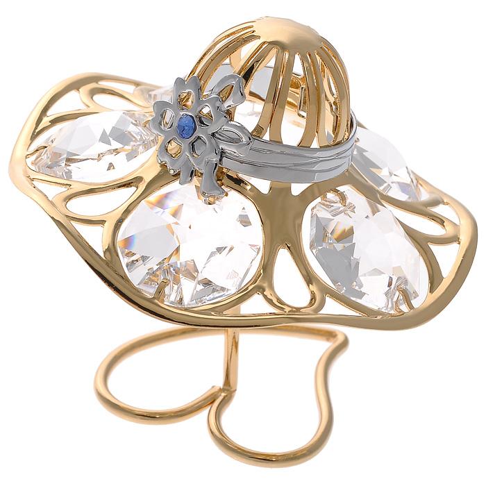 Фигурка декоративная Шляпка, цвет: золотистый67145Декоративная фигурка Шляпка, золотистого цвета, станет необычным аксессуаром для вашего интерьера и создаст незабываемую атмосферу. Фигурка выполнена в виде элегантной шляпки на подставке и инкрустирована белыми кристаллами. Кристаллы, украшающие фигурку, носят громкое имяSwarovski. Ограненные, как бриллианты, кристаллы блистают сотнями тысяч различных оттенков.Эта очаровательная вещь послужит отличным подарком близкому человеку, родственнику или другу, а также подарит приятные мгновения и окунет вас в лучшие воспоминания.Фигурка упакована в подарочную коробку. Характеристики:Материал: металл (углеродистая сталь, покрытие золотом 0,05 микрон), австрийские кристаллы. Размер фигурки: 5 см х 5 см х 3,5 см. Размер упаковки: 5 см х 3,5 см х 7,5 см. Артикул: 67145. Более чем 30 лет назад компанияCrystocraftвыросла из ведущего производителя в перспективную торговую марку, которая задает тенденцию благодаря безупречному чувству красоты и стиля. Компания создает изящные, качественные, яркие сувениры, декорированные кристалламиSwarovskiразличных размеров и оттенков, сочетающие в себе превосходное мастерство обработки металлов и самое высокое качество кристаллов. Каждое изделие оформлено в индивидуальной подарочной упаковке, что придает ему завершенный и презентабельный вид.