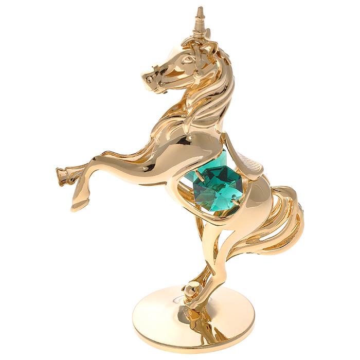 """Декоративная фигурка """"Единорог"""", золотистого цвета, станет необычным аксессуаром для вашего интерьера и создаст незабываемую атмосферу. Фигурка выполнена в виде единорога на подставке и инкрустирована зелеными кристаллами. Кристаллы, украшающие фигурку, носят громкое имя  Swarovski. Ограненные, как бриллианты, кристаллы блистают сотнями тысяч различных оттенков.   Эта очаровательная фигурка послужит отличным функциональным подарком, а также подарит приятные мгновения и окунет вас в лучшие воспоминания. Фигурка упакована в подарочную коробку.     Характеристики:  Материал: металл (углеродистая сталь, покрытие золотом 0,05 микрон), австрийские кристаллы. Размер фигурки: 6,5 см х 9,5 см х 3,5 см.  Цвет: золотистый. Размер упаковки: 7,5 см х 10 см х 5 см. Артикул: 67478.   Более чем 30 лет назад компания  """"Crystocraft""""  выросла из ведущего производителя в перспективную торговую марку, которая задает тенденцию благодаря безупречному чувству красоты и стиля.  Компания создает изящные, качественные, яркие сувениры, декорированные кристаллами  Swarovski различных размеров и оттенков, сочетающие в себе превосходное мастерство обработки металлов и самое высокое качество кристаллов.  Каждое изделие оформлено в индивидуальной подарочной упаковке, что придает ему завершенный и презентабельный вид."""