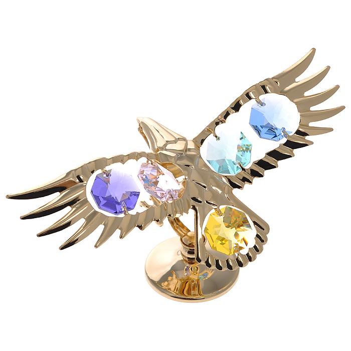 Фигурка декоративная Орел, цвет: золотистый67134Декоративная фигурка Орел, золотистого цвета, станет необычным аксессуаром для вашего интерьера и создаст незабываемую атмосферу. Фигурка выполнена в виде парящего орла на подставке и инкрустирована разноцветными кристаллами. Кристаллы, украшающие фигурку, носят громкое имяSwarovski. Ограненные, как бриллианты, кристаллы блистают сотнями тысяч различных оттенков.Эта очаровательная фигурка послужит отличным функциональным подарком, а также подарит приятные мгновения и окунет вас в лучшие воспоминания.Фигурка упакована в подарочную коробку. Характеристики:Материал: металл (углеродистая сталь, покрытие золотом 0,05 микрон), австрийские кристаллы. Размер фигурки: 11 см х 6 см х 5 см.Цвет: золотистый. Размер упаковки: 7,5 см х 10 см х 5 см. Артикул: 67134. Более чем 30 лет назад компанияCrystocraftвыросла из ведущего производителя в перспективную торговую марку, которая задает тенденцию благодаря безупречному чувству красоты и стиля. Компания создает изящные, качественные, яркие сувениры, декорированные кристалламиSwarovski различных размеров и оттенков, сочетающие в себе превосходное мастерство обработки металлов и самое высокое качество кристаллов. Каждое изделие оформлено в индивидуальной подарочной упаковке, что придает ему завершенный и презентабельный вид.