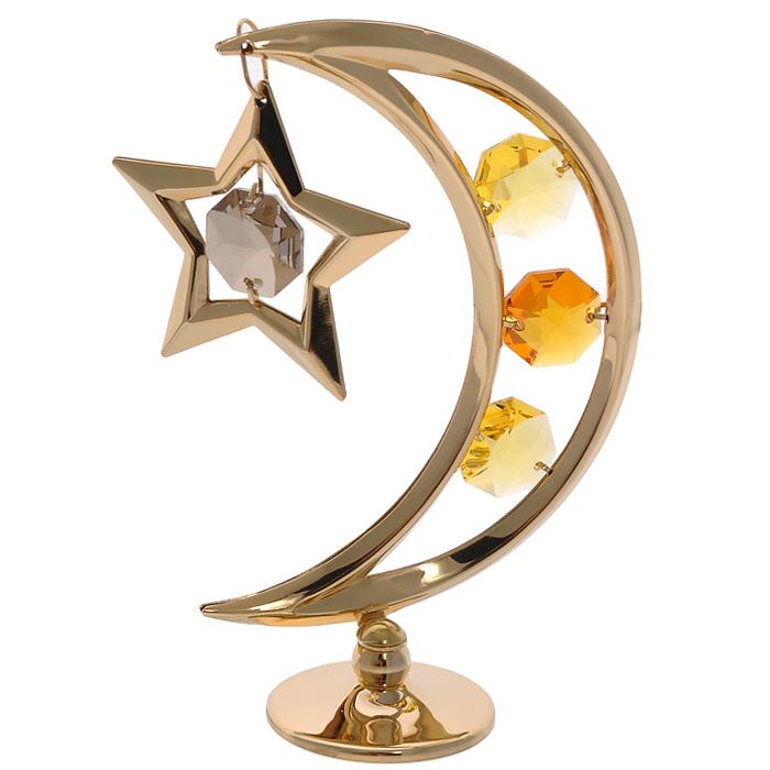 Фигурка декоративная Месяц, цвет: золотистый67435Декоративная фигурка Месяц, золотистого цвета, станет необычным аксессуаром для вашего интерьера и создаст незабываемую атмосферу. Фигурка выполнена в виде месяца на подставке с подвеской-звездой и инкрустирована желтыми кристаллами. Кристаллы, украшающие фигурку, носят громкое имяSwarovski. Ограненные, как бриллианты, кристаллы блистают сотнями тысяч различных оттенков. Эта очаровательная фигурка послужит отличным функциональным подарком, а также подарит приятные мгновения и окунет вас в лучшие воспоминания. Фигурка упакована в подарочную коробку. Характеристики:Материал: металл (углеродистая сталь, покрытие золотом 0,05 микрон), австрийские кристаллы. Размер фигурки: 7,5 см х 9 см х 3 см.Цвет: золотистый. Размер упаковки: 7,5 см х 10 см х 5 см. Артикул: 67435. Более чем 30 лет назад компанияCrystocraftвыросла из ведущего производителя в перспективную торговую марку, которая задает тенденцию благодаря безупречному чувству красоты и стиля.Компания создает изящные, качественные, яркие сувениры, декорированные кристалламиSwarovski различных размеров и оттенков, сочетающие в себе превосходное мастерство обработки металлов и самое высокое качество кристаллов.Каждое изделие оформлено в индивидуальной подарочной упаковке, что придает ему завершенный и презентабельный вид.