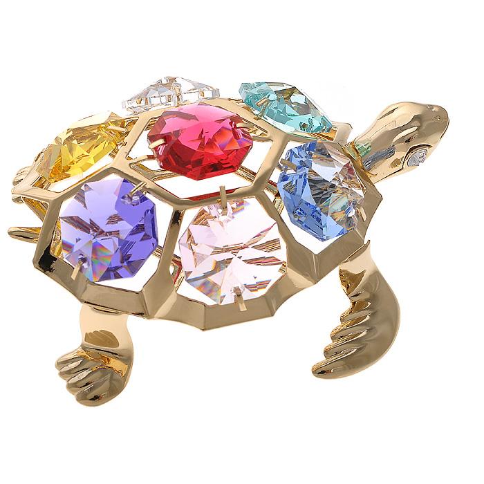 Фигурка декоративная Черепаха, цвет: золотистый67142Декоративная фигурка Черепаха, золотистого цвета, станет необычным аксессуаром для вашего интерьера и создаст незабываемую атмосферу. Фигурка выполнена в виде черепашки и инкрустирована разноцветными кристаллами. Кристаллы, украшающие фигурку, носят громкое имяSwarovski. Ограненные, как бриллианты, кристаллы блистают сотнями тысяч различных оттенков. Эта очаровательная фигурка послужит отличным функциональным подарком, а также подарит приятные мгновения и окунет вас в лучшие воспоминания. Фигурка упакована в подарочную коробку. Характеристики:Материал: металл (углеродистая сталь, покрытие золотом 0,05 микрон), австрийские кристаллы. Размер фигурки: 6,5 см х 5,3 см х 2,3 см.Цвет: золотистый. Размер упаковки: 6,5 см х 9 см х 4,5 см. Артикул: 67142. Более чем 30 лет назад компанияCrystocraftвыросла из ведущего производителя в перспективную торговую марку, которая задает тенденцию благодаря безупречному чувству красоты и стиля.Компания создает изящные, качественные, яркие сувениры, декорированные кристалламиSwarovski различных размеров и оттенков, сочетающие в себе превосходное мастерство обработки металлов и самое высокое качество кристаллов.Каждое изделие оформлено в индивидуальной подарочной упаковке, что придает ему завершенный и презентабельный вид.