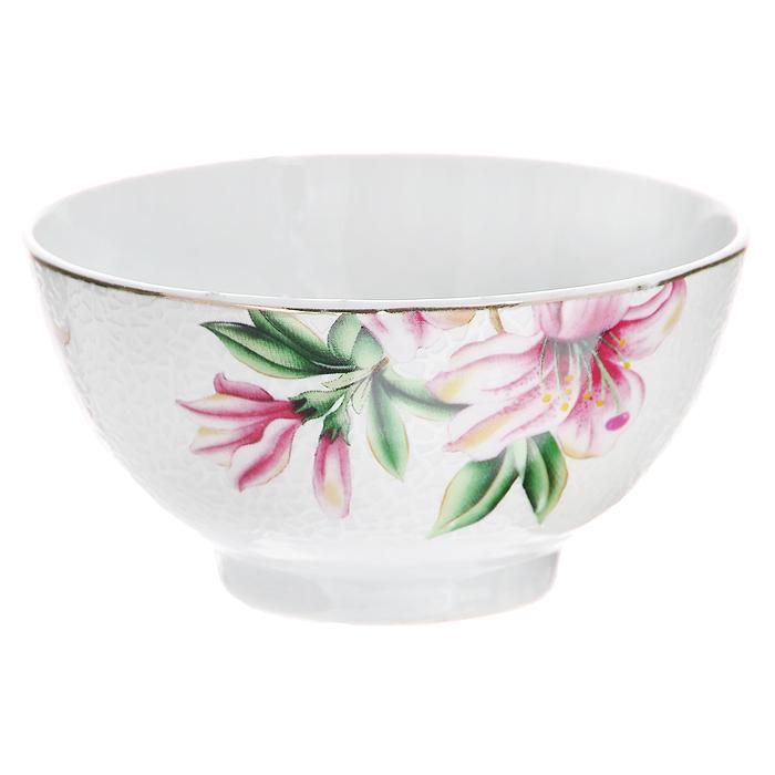 Пиала Розовая лилия, цвет: белый, диаметр 11 см545-480Пиала Розовая лилия, выполненная из высококачественного фарфора, оформлена изящным изображением розовой лилии. Пиала - это небольшая чашка без ручек, которая применялась уже со второй половины 1-го тысячелетия до нашей эры. Особо широкое распространение пиалы получили в Средней Азии, где их используют в чайных церемониях и для подачи риса. В России пиалы также широко используются. Характеристики:Материал:фарфор. Цвет:белый. Диаметр пиалы по верхнему краю:11 см. Высота пиалы: 5,5 см. Размер упаковки:12 см х 11,5 см х 6 см. Артикул:545-480.