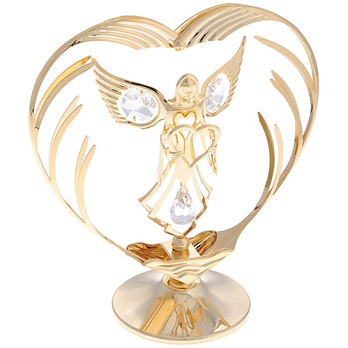 Фигурка декоративная Ангел с сердцем. 6757967579Декоративная фигурка Ангел с сердцем изготовлена из металла с золотым покрытием толщиной 0,05 микрон. Фигурка выполнена в виде ангела, держащего сердце, и украшена белыми кристаллами Swarovski. Поставьте украшение на полку или стол и наслаждайтесь изящными формами и блеском кристаллов. Изысканная и эффектная, эта фигурка покорит своей красотой и изумительным качеством исполнения, а также станет замечательным подарком и вызовет восхищение у получателя. Характеристики:Материал: металл (углеродная сталь), кристаллы Swarovski. Размер прибора: 12,5 см х 6 см х 13,5 см. Размер упаковки: 18 см х 14 см х 7,5 см. Артикул: 67579.