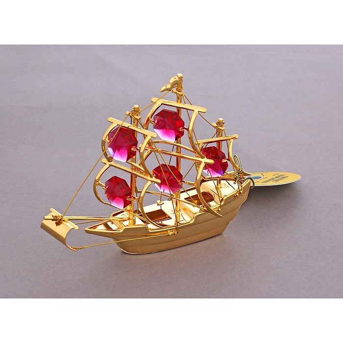 Фигурка декоративная Корабль, цвет: золотистый. 672671672671Декоративная фигурка Корабль выполнена из металла золотистого цвета и украшена красными кристаллами Swarovski. Поставьте фигурку на стол в офисе или дома и наслаждайтесь изящными формами и блеском кристаллов.Изысканный и эффектный, этот сувенир покорит своей красотой и изумительным качеством исполнения, а также станет замечательным подарком. Характеристики:Материал: металл, кристаллы Swarovski. Размер фигурки: 10 см х 2,5 см х 8 см. Цвет: золотистый. Размер упаковки: 10 см х 3 см х 9 см. Артикул: 672671.