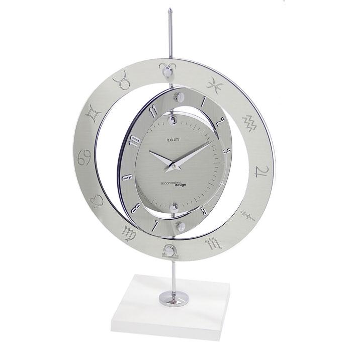 Часы настольные Три плоскости, кварцевые. 654268654268Оригинальные настольные часы Три плоскости выполнены из синтетического стекла и представляют собой стойку на подставке с круглым диском и двумя вращающимися вокруг него кольцами. Циферблат оформлен двумя стрелками часовой и минутной и делениями, обозначающие секунды. На первом кольце нанесены цифры, на втором - знаки зодиака. На задней стенке расположен блок с часовым механизмом.В набор для самостоятельной сборки часов входит: стойка с циферблатом и вращающимися кольцами, подставка, шестигранный ключ и инструкция по сборке. Необычное дизайнерское решение и качество исполнения придутся по вкусу каждому.Оформите совой дом таким интерьерным аксессуаром или преподнесите его в качестве презента друзьям, и они оценят ваш оригинальный вкус и неординарность подарка. Характеристики:Материал: синтетическое стекло, металл, пластик. Тип механизма:плавающий, бесшумный. Размер часов (в собранном виде):49 см х 33 см х 17 см. Диаметр основного циферблата:16,5 см. Общий диаметр часов:33 см. Ширина первого вращающегося кольца:3 см. Ширина второго вращающегося кольца:4 см. Размер подставки:17 см х 17 см х 2 см. Размер упаковки:47 см х 46 см х 5 см. Рекомендуется докупить батарейку типа АА (не входит в комплект).