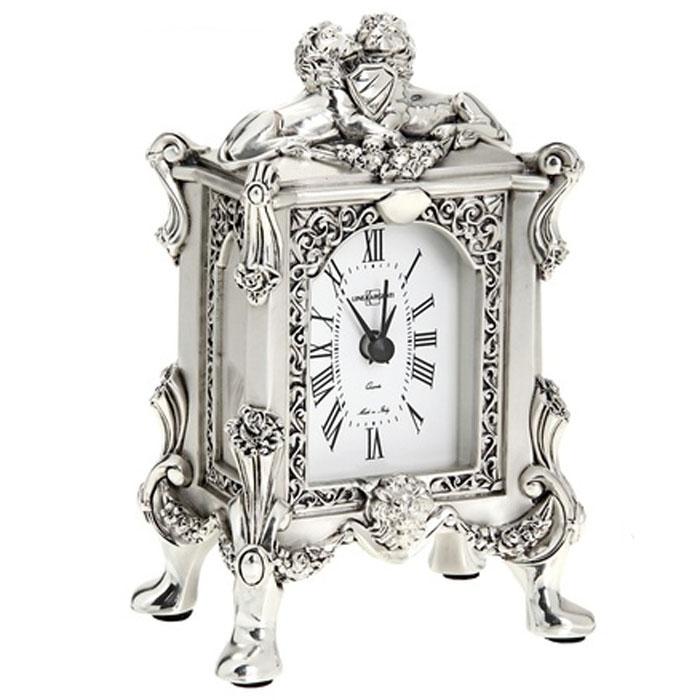 Часы настольные Linea Argenti, цвет: серебристый. 665837665837Изысканные настольные часы Linea Argenti с кварцевым механизмом выполнены из высокопрочной смолы с покрытием серебром высшей пробы в стиле эпохи Ренессанс. Циферблат оформлен римскими цифрами и имеет три стрелки - часовую, минутную и секундную. Часы - это не только функциональное устройство, но и оригинальный элемент декора, который впишется в любой интерьер.Благодаря стильному дизайну, качеству исполнения и практичности часы смогут стать великолепным подарком, который подчеркнет утонченный вкус своего обладателя. Характеристики:Материал: высокопрочная смола, серебро 999.Размер: 7 см x 10 см x 16 см.Артикул: 665837.