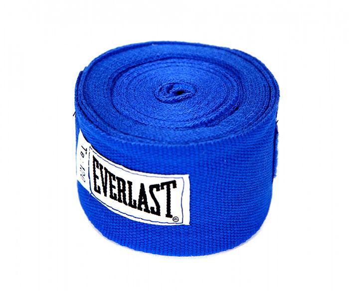 Бинты боксерские хлопковые Everlast, длина 3 м, цвет: синий4454RBUПрофессиональные бинты предназначены для занятий боксом и единоборствами. Изготовлены из хлопка с добавлением полиэстера. Застежка на липучке. Характеристики: Материал: хлопок. Длина бинта: 300 см. Размер упаковки: 23 см х 15 см х 6 см.