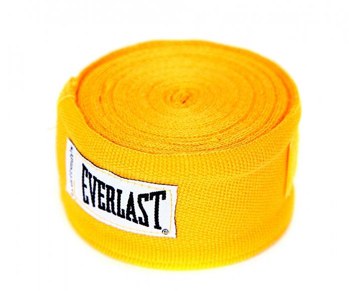 Бинты боксерские эластичные Everlast, длина 4,55 м, цвет: желтый, 2 шт4456GUПрофессиональные бинты предназначены для занятий боксом и единоборствами. Изготовлены из полиамида с добавлением полиэстера. Застежка на липучке. Характеристики: Материал: полиамид, полиэстер. Длина бинта: 455 см.Комплектация: 2 шт. Размер упаковки: 23 см х 15 см х 5 см.