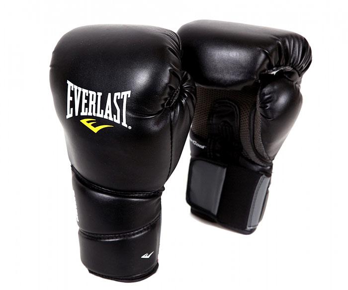 Перчатки тренировочные Everlast Protex2 Training Gloves, цвет: черный, 12 унцийP00000727Тренировочные боксерские перчатки Protex 2 Training Gloves. Мелкие отверстия по всей площади ладони обеспечивают дыхание и комфорт руки, в то время как антибактериальная пропитка активно борется с плохим запахом и ростом бактерий. Характеристики: Цвет:черный. Ширина манжеты:12 см. Общая длина перчатки:30 см. Ширина (с учетом большого пальца):16 см. Производитель:Китай. Размер упаковки: 36 см х 17 см х 13 см. Артикул:3112SMU.