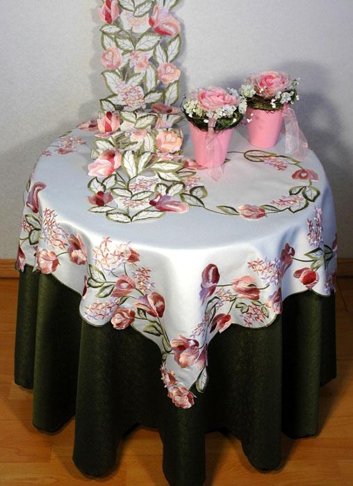 """Квадратная скатерть """"Schaefer"""" выполнена из полиэстера белого цвета с розовыми тюльпанами в технике ришелье.   Изделия из полиэстера легко стирать: они не мнутся, не садятся и быстро сохнут, они более долговечны, чем изделия из натуральных волокон.   Использование такой скатерти сделает застолье более торжественным, поднимет настроение гостей и приятно удивит их вашим изысканным вкусом. Также вы можете использовать эту скатерть для повседневной трапезы, превратив каждый прием пищи в волшебный праздник и веселье.   Характеристики:  Материал: 100% полиэстер. Цвет: белый. Размер скатерти:  85 см х 85 см. Артикул:  06008-100.   Немецкая компания """"Schaefer"""" создана в 1921 году. На протяжении всего времени существования она создает уникальные коллекции домашнего текстиля для гостиных, спален, кухонь и ванных комнат.  Дизайнерские идеи немецких художников компании """"Schaefer"""" воплощаются в текстильных изделиях, которые сделают ваш дом красивее и уютнее и не останутся незамеченными вашими гостями. Дарите себе и близким красоту каждый день!"""
