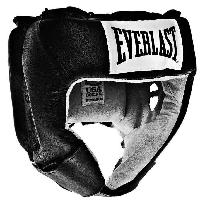 """Тренировочный боксерский шлем Everlast """"USA Boxing"""" черного цвета предназначен для предохранения головы от жестких ударов, травмирования бровей, ушей и лица. Внешняя поверхность шлема выполнена из натуральной кожи, внутренняя поверхность - из замши. Шлем обеспечивает защиту в области лба, ушей и скул, а также создает дополнительный комфорт за счет анатомической подушки в тыльной части. Шлем регулируется по ширине в верхней части и прочно фиксируется на голове при помощи шнуровки. На подбородке шлем застегивается на прочную застежку на липучке.  Такой шлем погасит силу ударов и надежно защитит все зоны головы от повреждений. Характеристики:  Размер: L. Цвет: черный. Минимальный размер шлема: 20 см х 20 см х 24 см. Толщина наполнителя: 3 см. Материал:  натуральная кожа, замша, текстиль. Изготовитель:  Китай. Артикул:  610401U."""