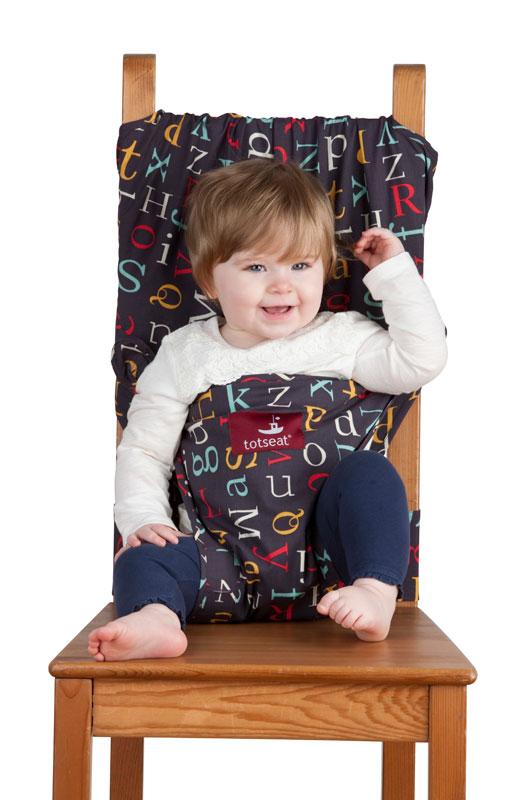 Дорожный детский стульчик Totseat, цвет: темно-синий с буквами1000100152Дорожный детский стульчик Totseat - незаменимая вещь в дороге или в гостях, если вы решили покормить малыша, а под рукой нет детского стульчика. Удобный, легкий и компактный - он весит всего 360 г, легко стирается, подходит для любого обычного стула со спинкой и легко поместится в женскую сумку.Его очень легко использовать: накиньте на стул, отрегулируйте длину и защелкните. Этот компактный стульчик для кормления, предназначенный для детей от 8 до 30 месяцев, подходит для любого обычного стула со спинкой.Totseat - это отличный подарок и полезный аксессуар в поездке. Вы можете взять его на пикник и посадить кроху отдыхать в шезлонге. А дополнительная упаковочная сумочка на молнии отлично подойдет для мокрого слюнявчика!В комплект входит мешочек для хранения.Больше информации вы найдете на сайте http://totseat.ru/Инструкция по использованию:http://www.youtube.com/watch?v=KzBqR6yM8Uw&hd=1или http://totseat.ru/index.php?route=information/information&information_id=3Видео демонстрация:http://www.youtube.com/watch?v=ERr-0IlZe9sили http://totseat.ru/index.php?route=information/information&information_id=4 Характеристики:Материал:50% хлопок, 50% полиэстер. Рекомендуемый возраст:от 6 до 30 месяцев. Размер упаковки (ДхШхВ):14 см х 17 см x 6,5 см. Изготовитель: Китай.