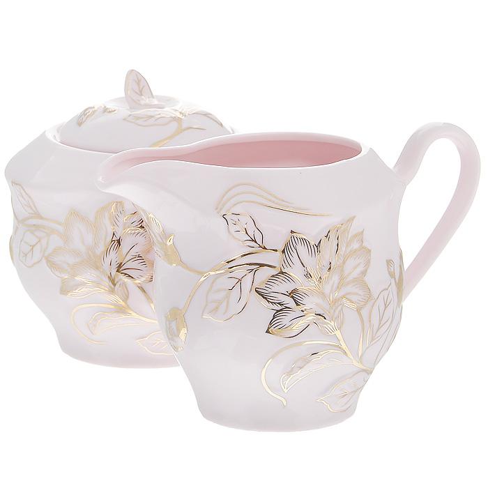 Набор Розовая лиана, цвет: розовый, 2 предмета595-112Набор Розовая лиана состоит из сахарницы и молочника, выполненных из высококачественного фарфора розового цвета. Изделия оформлены изящным рельефным узором золотистого цвета. Такой набор прекрасно подойдет для сервировки стола и станет незаменимым атрибутом чаепития. Набор упакован в подарочную коробку золотистого цвета, задрапированную атласной тканью белого цвета. Характеристики:Материал: фарфор. Цвет: розовый. Объем молочника: 380 мл. Размер молочника по верхнему краю: 5,5 см х 9 см. Высота молочника: 9 см. Объем сахарницы: 380 мл. Диаметр сахарницы по верхнему краю: 7 см. Высота сахарницы (с учетом крышки): 10 см. Размер упаковки: 26 см х 13,5 см х 11,5 см. Артикул: 595-112.