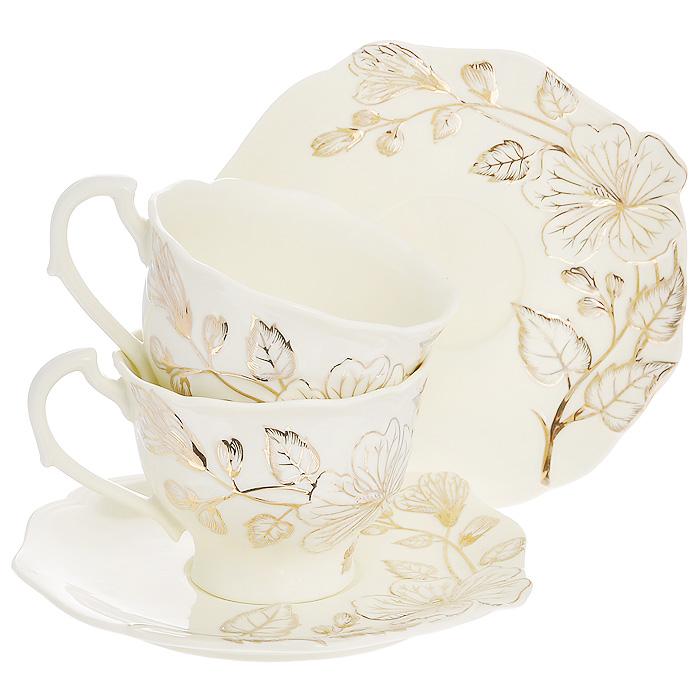 Набор чайный Желтый цветок, 4 предмета595-108Чайный набор Желтый цветок, выполненный из высококачественного фарфора молочного цвета, состоит из двух чашек и двух блюдец. Изделия декорированы рельефным цветком, покрытым золотистой эмалью. Элегантный дизайн и совершенные формы предметов набора привлекут к себе внимание и украсят интерьер вашей кухни. Чайный набор Желтый цветок идеально подойдет для сервировки стола и станет отличным подарком к любому празднику.Чайный набор упакован в подарочную коробку из плотного картона золотистого цвета. Внутренняя часть коробки задрапирована белой атласной тканью, и каждый предмет надежно крепится в определенном положении благодаря особым выемкам в коробке. Характеристики:Материал:фарфор. Объем чашки:200 мл. Диаметр чашки по верхнему краю: 9 см. Высота чашки: 6,7 см. Диаметр блюдца: 15 см. Размер упаковки: 23 см х 18 см х 11 см. Артикул: 595-108.