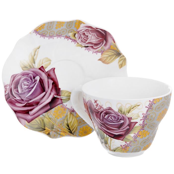 Набор чайный Розы на орнаменте, 2 предмета516-065Чайный набор Розы на орнаменте, выполненный из высококачественного фарфора, состоит из чашки и блюдца. Изделия декорированы изображением роз. Элегантный дизайн и совершенные формы предметов набора привлекут к себе внимание и украсят интерьер вашей кухни. Чайный набор Розы на орнаменте идеально подойдет для сервировки стола и станет отличным подарком к любому празднику.Чайный набор упакован в подарочную коробку с бантом. Характеристики:Материал:фарфор. Объем чашки:220 мл. Диаметр чашки по верхнему краю: 9,5 см. Высота чашки: 7 см. Диаметр блюдца: 14 см. Размер упаковки: 14,5 см х 14,5 см х 8 см. Артикул: 516-065.