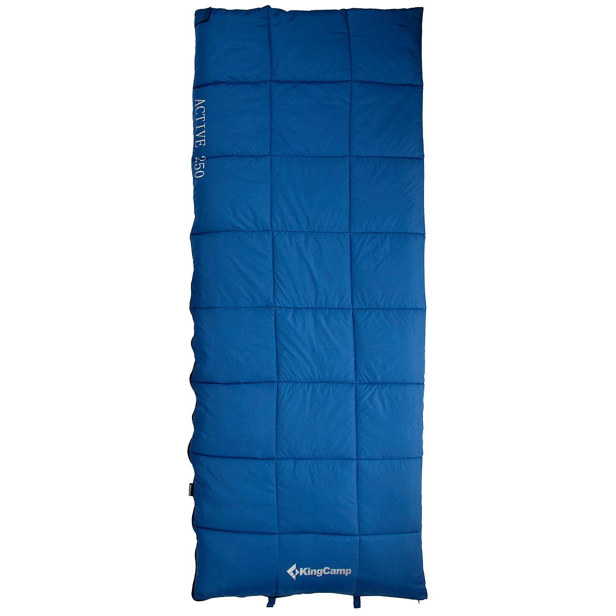 Спальный мешок-одеяло KingCamp ACTIVE 250, цвет: синий. ks3103УТ-000050401Комфортный спальник-одеяло имеет прямоугольную форму и одинаковую ширину как вверху, так и внизу, благодаря чему ноги чувствуют себя более свободно. Молния располагается на боковой стороне, благодаря чему при её расстёгивании спальник превращается в довольно большое одеяло. Характеристики:Размер спального мешка с учетом подголовника: 190 см х 75 см. Утеплитель: четырехканальное волокно Hollowfibre, 250 г/м2. Внешний материал: полиэстер 210Т RipStop W/P. Внутренний материал: 100% хлопок. Экстремальная температура: -5°C. Температура комфорта: 6°C...12°С. Вес: 1,45 кг. Изготовитель:Китай. Размер в сложенном виде: 35 см х 22 см х 22 см. Артикул:KS3103.