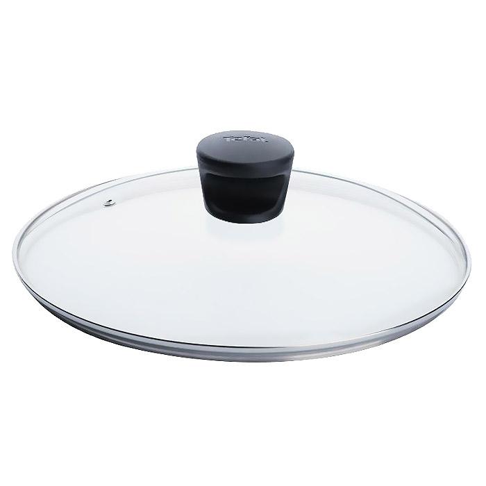 """Крышка """"Tefal"""" изготовлена из термостойкого стекла. Обод, выполненный из высококачественной нержавеющей стали, защищает крышку от повреждений, а ручка, выполненная из термостойкого пластика, защищает ваши руки от высоких температур. Крышка удобна в использовании, позволяет контролировать процесс приготовления пищи. Имеется отверстие для выпуска пара. Характеристики:  Материал: стекло, нержавеющая сталь, пластик. Диаметр: 28 см. Производитель: Франция. Изготовитель: Россия. Артикул: 040 90 128.   Дизайнер, производитель, пионер в области новейших технологий уже 50 лет, """"Tefal"""" представляет практичную и надежную кухонную посуду, которая отвечает современным требованиям. Создавая новое, """"Tefal"""" всегда стремится улучшить результаты приготовления пищи. Новинки намного упрощают цикл приготовления: ингредиенты не подгорают и сохраняют свой первозданный вкус,  посуда отличается легкостью очистки. Индикатор нагрева для совершенства рецептов, возможность выбора посуды для индукционных плит, инновационное решение проблемы хранения посуды и, как следствие, безупречное приготовление пищи!"""
