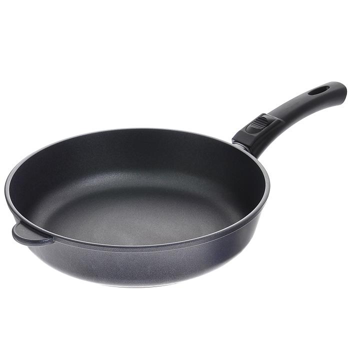 Сковорода литая Нева Металл Посуда Особенная с антипригарным покрытием, со съемной ручкой. Диаметр 28 см9028Сковорода Особенная изготовлена из литого алюминия с полимер-керамическим антипригарным покрытием повышенной износостойкости Титан. Вы можете пользоваться металлическими столовыми приборами, готовя в ней пищу. Четырехслойная система Титан имеет исключительную прочность за счет ее особой структуры, способа нанесения, значительной толщины - около 100 микрон (для сравнения, толщина покрытия на посуде других производителей 21-40 микрон).Четырехслойная полимер-керамическая антипригарная система Титан:верхний слой на водной основе;промежуточный слой на водной основе;полимер-керамический слой;твердая керамическая основа.Антипригарное покрытие на водной основе относится к самому безопасному, четвертому классу по ГОСТу. Оно традиционно производится без использования PFOA (перфтороктановой кислоты). Литой корпус сковороды сделан по принципу золотого сечения, с толстыми стенками и еще более толстым дном, из специального пищевого сплава алюминия с кремнием. Это обеспечивает исключительные термоаккумулирующие свойства посуды. Она равномерно прогревается и долго удерживает тепло. Создается эффект томления. Приготовленное блюдо получается особенно вкусным, а в продуктах сохраняется больше полезных веществ.Корпус, отлитый вручную, практически не подвержен деформации даже при сильном нагреве. Сковорода оснащена эргономичной съемной ручкой, выполненной из бакелита.Сковорода подходит для использования на газовых, электрических и стеклокерамических плитах, в духовом шкафу (без ручки); ее можно мыть в посудомоечной машине. Характеристики: Материал: литой алюминий, бакелит. Внутренний диаметр сковороды: 28 см. Высота стенок сковороды: 7 см. Толщина стенок сковороды: 0,4 см. Толщина дна сковороды: 0,6 см. Диаметр диска сковороды: 22 см. Длина ручки сковороды: 19 см. Артикул: 9028.