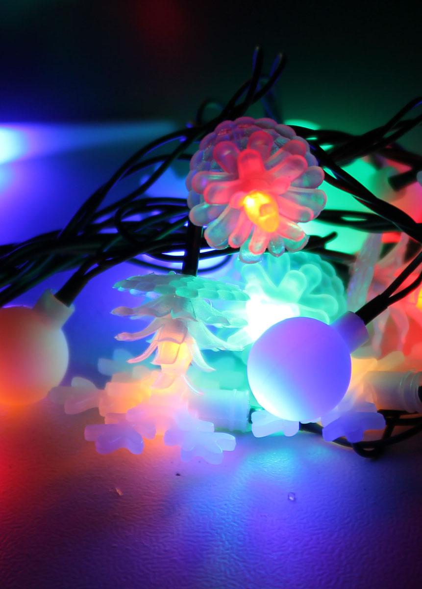 Светодиодная гирлянда Космос Новогодние игрушки, 30 светодиодов, цвет свечения: мульти, 4,4 мKOC_GIR30LEDMIX2_RGBСветодиодная гирлянда Космос Новогодние игрушки с пластиковыми насадками в виде снежинок, шишечек и шариков отлично подойдет для украшения новогодней елки, окна или стены. На гирлянде расположено 30 лампочек. Провод гирлянды прозрачного цвета оснащен прямоугольным контролером с кнопкой для переключения восьми режимов. Режимы мигания электрогирлянды: combination (комбинированный); in wales (волна); sequentian (последовательный); slo-glo;chasing/flash (чеканка/вспышка) ; slow fade (медленное затухание);twinkle/flash (мерцание/вспышка); steady on (постоянный). Светодиодная гирлянда Космос Новогодние игрушки создаст праздничную атмосферу и наполнит ваш дом радостью и позитивной энергией. Характеристики:Материал: пластик. Цвет свечения: мульти. Количество светодиодов: 30 шт. Длина гирлянды: 4,4 м. Средний размер игрушки: 4 см х 4 см. Режимы мигания: 8. Электропитание (от сети): 230 В. Артикул: KOC_GIR30LEDMIX2_RGB.